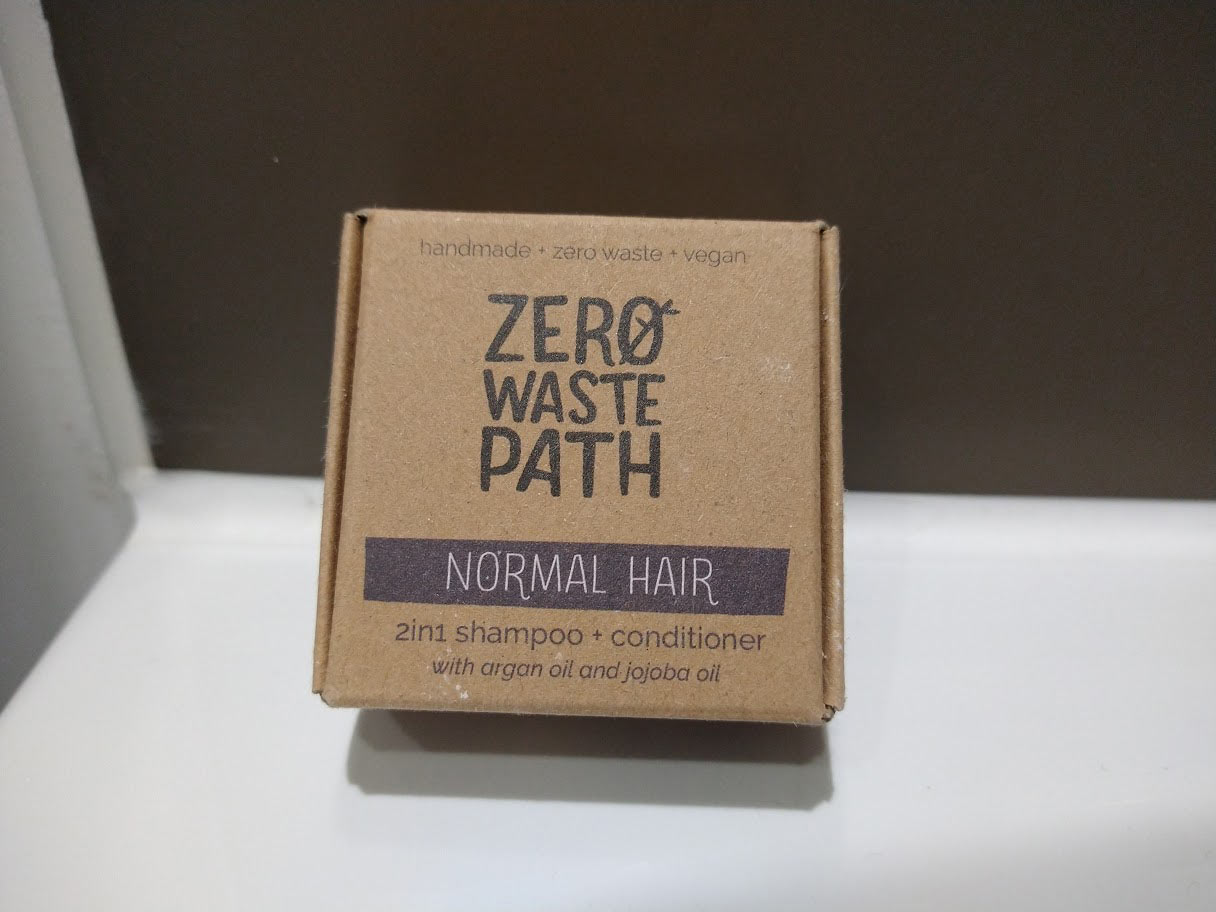 The Zero Waste Path shampoo bar's simplistic cardboard packaging.
