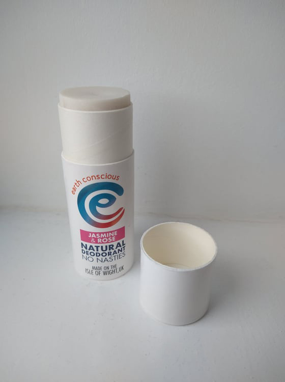 The white cardboard tube of Jasmine & Rose Earth Conscious, with the lid beside it.